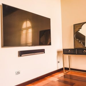 75 inch TV mounted with a Soundbar